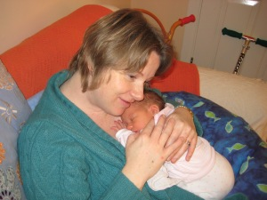 Jayne holding her youngest, Daisy, 2008